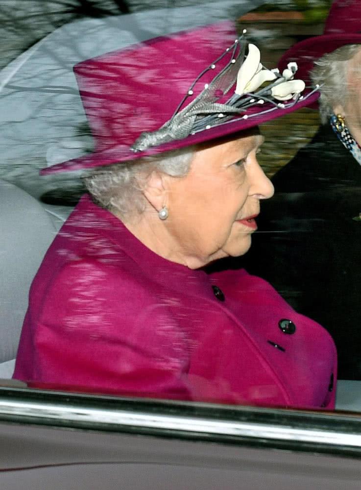 Queen Elizabeth II rose red style